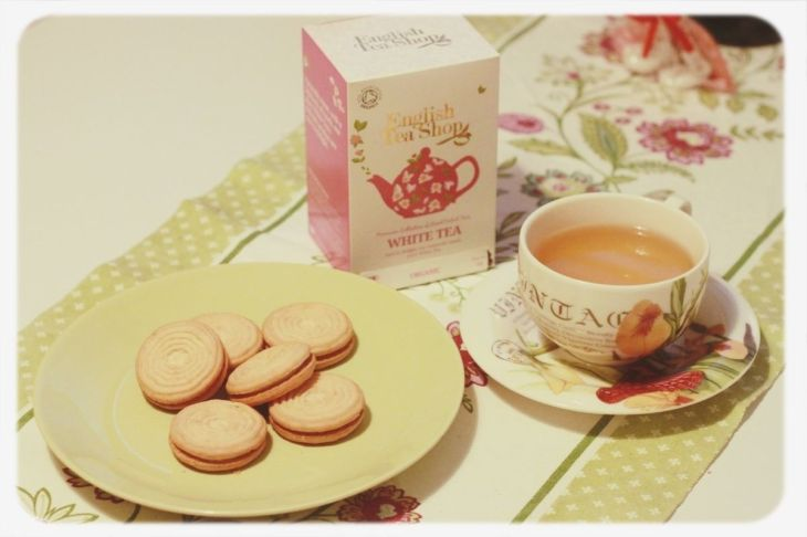 "Tea and cookies. We didn't even pay attention what was inside the tea box, it was bought simply because of how cute it was. Fortunately, the tea was good. The cookies had blueberry jelly on top (at the other side :"")) and cream in between. The cup was pretty, so was the tablecloth. ❤"