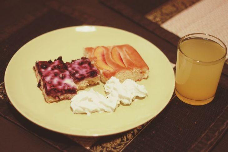 blueberry + lingonberry pie, apple pie, cream, and orange juice.